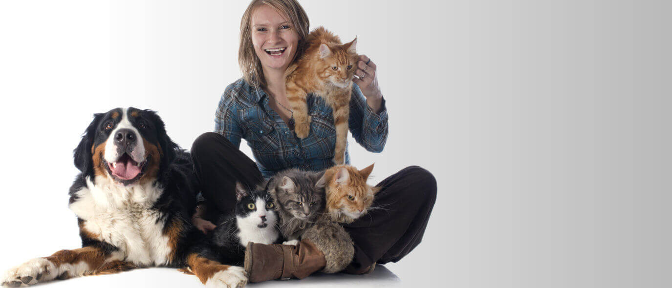 woman with dog and four cats