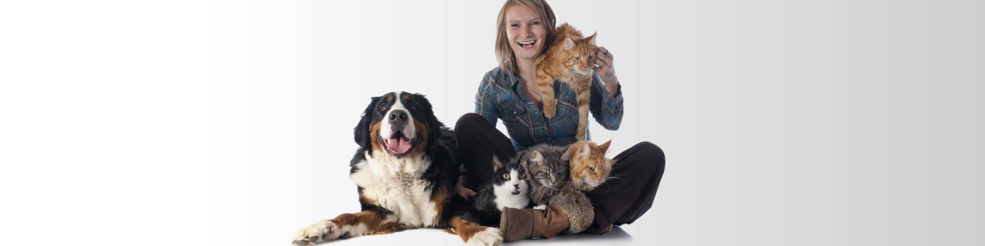 woman and pet in front of white background